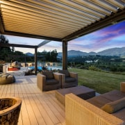 The word 'relax' comes to mind with this estate, home, interior design, outdoor structure, patio, property, real estate, roof, brown
