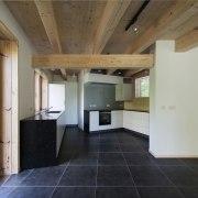 Large, dark tiles run throughout the ground floor architecture, ceiling, daylighting, estate, floor, flooring, house, interior design, property, real estate, wood flooring, gray, brown