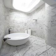 Marble runs across the floor – and up bathroom, bathroom sink, bidet, ceramic, floor, flooring, interior design, plumbing fixture, product design, room, sink, tap, tile, toilet seat, wall, gray, white