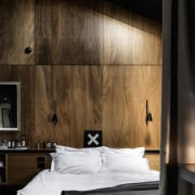 Sunlight reflects off the wood panel walls - architecture, bed, bed frame, bedroom, ceiling, floor, furniture, interior design, lighting, room, wall, wood, black