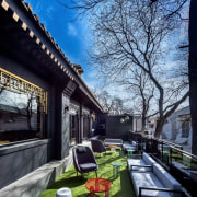 Outdoor seating areas take advantage of the sun architecture, building, car, home, house, neighbourhood, plant, residential area, roof, sky, tree, woody plant, black