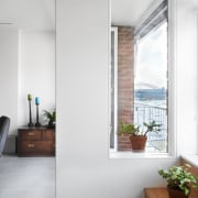 You can see Sydney Harbour Bridge in the apartment, home, house, interior design, real estate, window, white