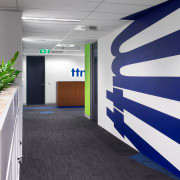 The TTM graphics spread out of the walls interior design, office, white, blue