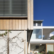 Wood and concrete make up the exterior of architecture, building, daylighting, facade, home, house, real estate, residential area, siding, window, white, black