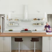 The light-filled kitchen has a separate scullery and cabinetry, countertop, cuisine classique, furniture, interior design, kitchen, room, white, gray