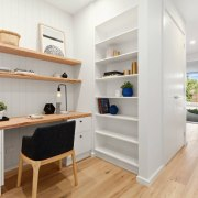 A combination home office/study and storage area is floor, interior design, property, real estate, shelf, shelving, gray