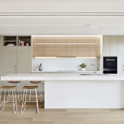 The kitchen is clean, spacious and open. There's architecture, floor, furniture, house, interior design, kitchen, product design, table, gray, white
