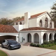 A home with Tesla Solar Roof tiles installed building, estate, facade, hacienda, home, house, mansion, property, real estate, residential area, roof, villa, gray, brown