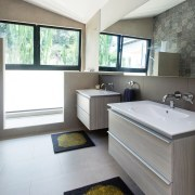 This large bathroom features wet room stylings and architecture, bathroom, floor, interior design, room, sink, white, gray