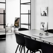 The dining area with angled mirrors - The black and white, chair, furniture, interior design, product design, shelf, shelving, table, white