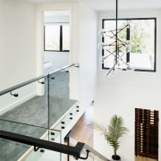 This stairway area is certainly improved by the floor, glass, handrail, home, house, interior design, wall, window, white