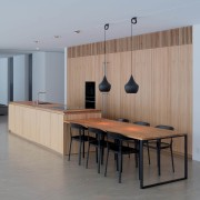 A dining table running off the kitchen island architecture, floor, flooring, furniture, interior design, plywood, product design, table, wood, gray