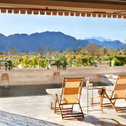 The property looks out to distant mountains backyard, estate, home, house, interior design, outdoor structure, patio, property, real estate, resort, wall, window, white