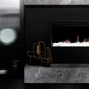 A fireplace draws the eye in this lounge fireplace, hearth, interior design, black