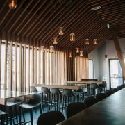 Douglas fir runs down into the floor - architecture, ceiling, function hall, interior design, restaurant, table, black