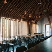 Douglas fir runs down into the floor architecture, ceiling, function hall, interior design, restaurant, table, black