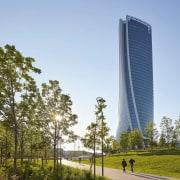 The new tower rises up above Milan architecture, building, condominium, corporate headquarters, daytime, metropolitan area, sky, skyscraper, tower, tower block, tree, teal