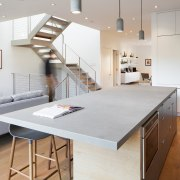Another view of the kitchen island and stairway countertop, cuisine classique, floor, furniture, interior design, kitchen, product design, table, wood flooring, gray
