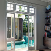The pool is always present, in this case door, home, interior design, window, gray