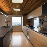 Recessed handles read as long lines, connecting to architecture, ceiling, countertop, daylighting, house, interior design, kitchen, real estate, room, brown