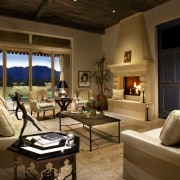 The living area features a fireplace and an home, interior design, living room, real estate, room, brown