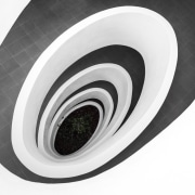 This ramp spirals down to the ground floor automotive tire, black and white, product, product design, wheel, white