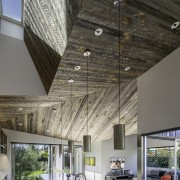 The kitchen has a church-like feeling thanks to architecture, ceiling, daylighting, house, interior design, gray, black