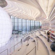 The sculptural atrium at the heart of the airport terminal, architecture, building, daylighting, shopping mall, structure, gray, white
