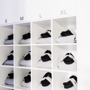 Cryotherapy clothing sits in appropriate alcoves footwear, furniture, product, product design, shelf, shelving, shoe, shoe store, white