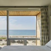 From the bedroom, there are limitless views - door, home, house, interior design, real estate, window, wood, gray