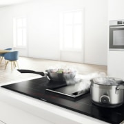 Bosch induction cooktops: less waiting, lower power consumption countertop, furniture, home appliance, interior design, kitchen, kitchen appliance, kitchen stove, major appliance, small appliance, table, tap, white