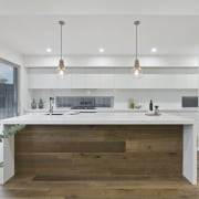 Pendant lights hang down over the island - architecture, cabinetry, countertop, cuisine classique, floor, interior design, kitchen, gray, brown