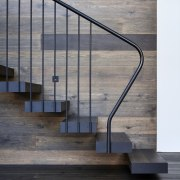 A metal balustrade holds up the staircase - architecture, glass, handrail, iron, stairs, gray, black