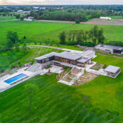 The rural Millgrove House is expansive and accommodating aerial photography, bird's eye view, estate, farm, grass, house, land lot, landscape, property, real estate, rural area, water resources, green