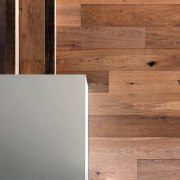 A view of the wood floor - A floor, flooring, hardwood, lumber, plywood, wood, wood flooring, wood stain, brown, gray