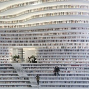 The Tianjin Binhai Library holds 1.2 million books. building, sport venue, structure, gray, white