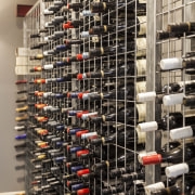 The wine cellar is simple and functional - inventory, wine cellar, black, gray