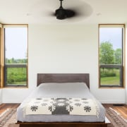 Each room receives plenty of natural light - architecture, bed frame, bedroom, ceiling, estate, home, house, interior design, property, real estate, room, window, wood, white