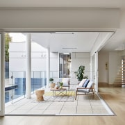 The doors open up, connecting the interior and architecture, daylighting, door, floor, home, house, interior design, living room, real estate, window, gray