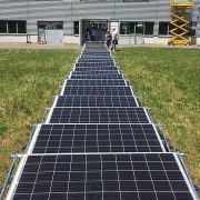 Transportable Solar Microgrid asphalt, grass, road surface, solar energy, solar panel, solar power, walkway, brown, black