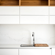 A sink sits below clean cabinets floor, furniture, plywood, product, product design, shelf, sideboard, table, tap, wall, wood, white