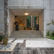 A concrete box-like structure and steps create an architecture, courtyard, door, facade, house, window, gray