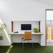 This office area sits tucked into the wall architecture, desk, furniture, house, interior design, office, real estate, table, window, white