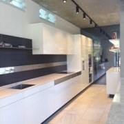 Handless cabinetry, accessed with +Motion Drive by Poggenpohl, countertop, floor, glass, interior design, gray