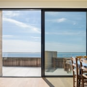 The dining room has uninterrupted views of the apartment, condominium, door, home, house, interior design, penthouse apartment, property, real estate, window, gray, white