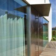 Architect: Tisselli Studio architecture, daylighting, facade, glass, house