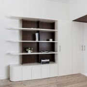 A tidy shelf unit merges into cupboards bookcase, furniture, interior design, shelf, shelving, gray, white