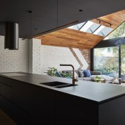 A high pitched ceiling in the lounge creates architecture, countertop, daylighting, house, interior design, kitchen, black