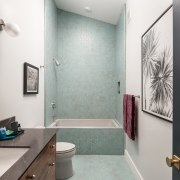 A large shower occupies the end of this bathroom, home, interior design, property, room, gray, white