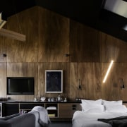 The large skylight looks down on the bedroom architecture, ceiling, house, interior design, wall, wood, black